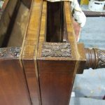 An Irish Mahogany Roll Top Desk, Circa 1820. Repairs being carried out to damaged astragal moulding prior to colouring out.
